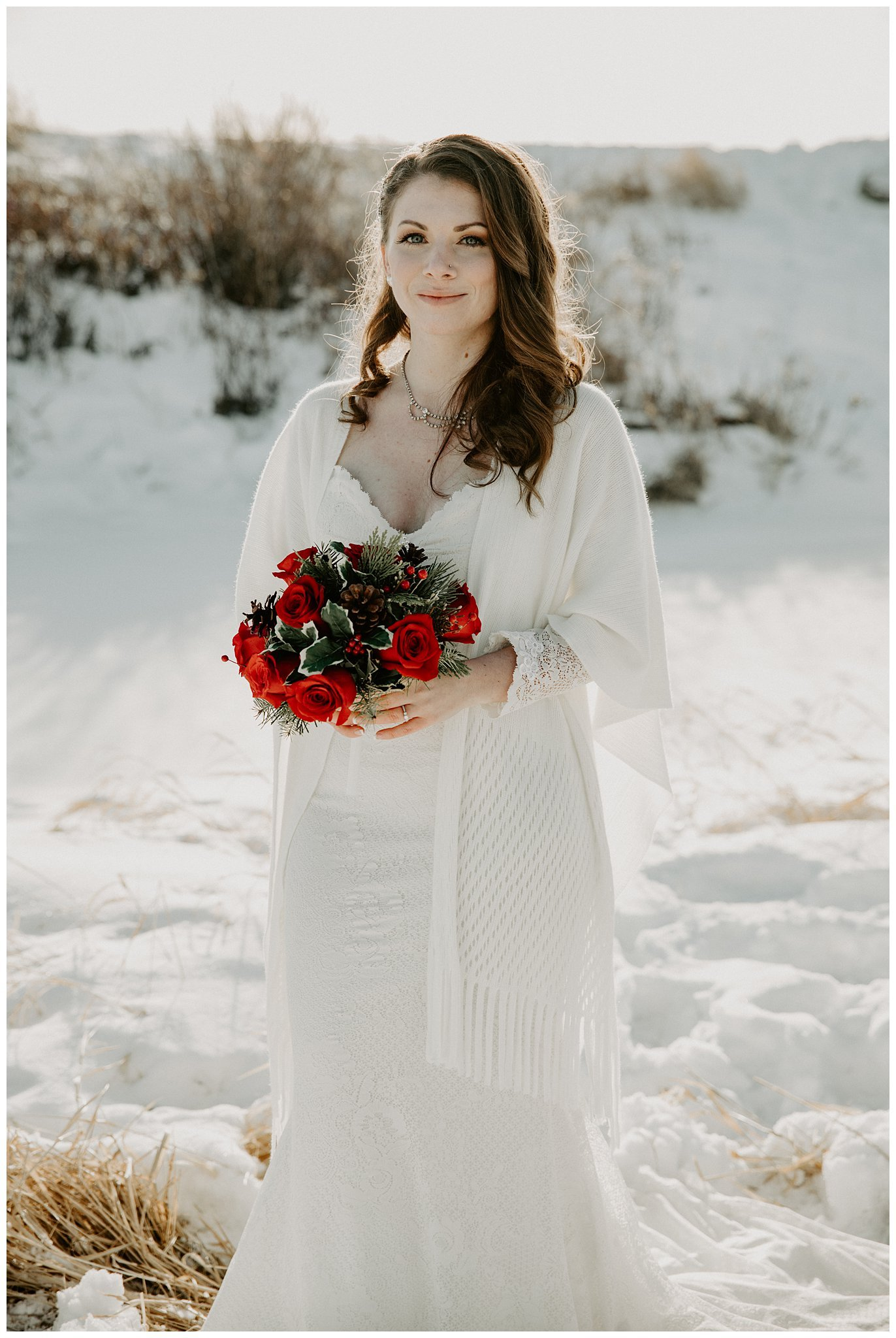 Winter wedding bride with red bouquet