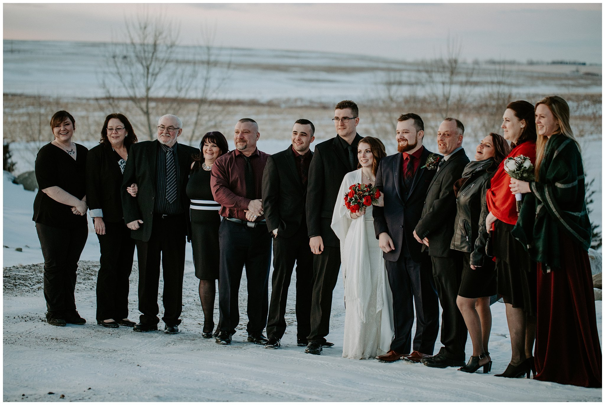 Large group family photos at wedding