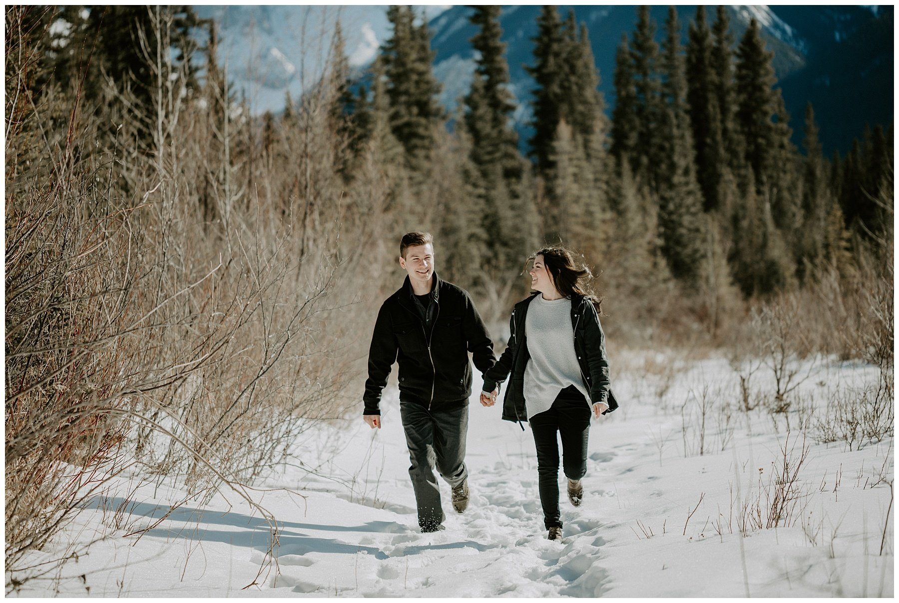 Running through the mountains engagement photo
