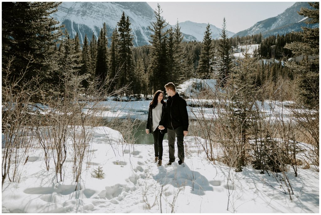 canmore engagement photos by the river in the spring