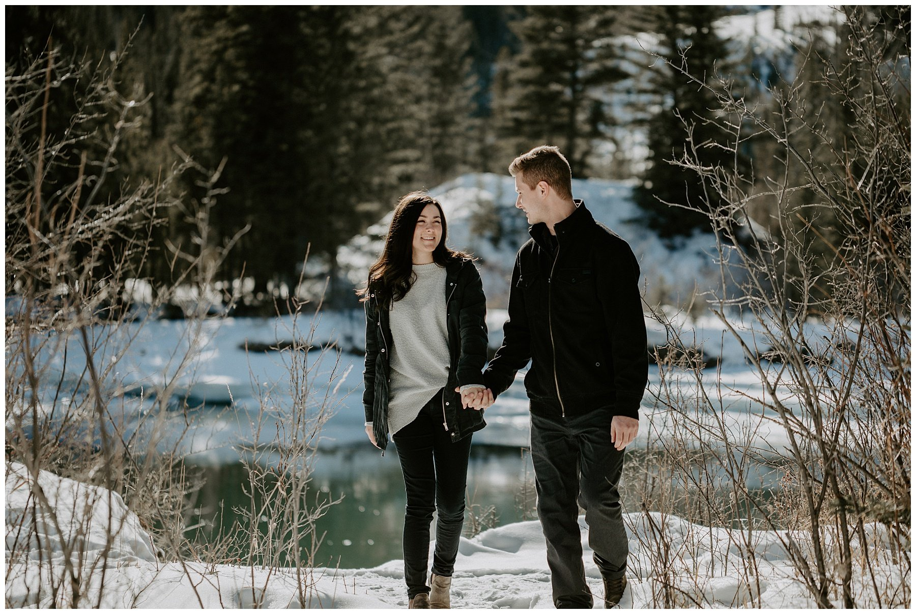 canmore engagement photos by the river